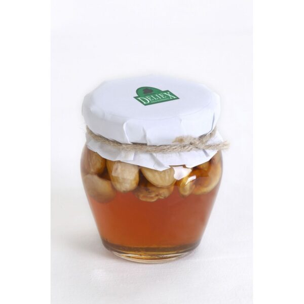 miniatura tarro de miel con almendras